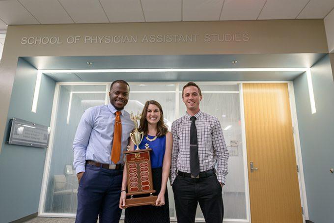 UF PA students Olatunde Oshikoya, Jessica Buchko and Kyle Proffitt with trophy